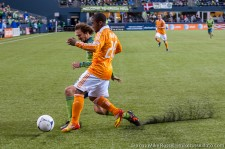 Roger Levesque and Corey Ashe chase down the ball