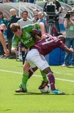 Alex Caskey shows some skill as he fights Omar Cummings for the ball