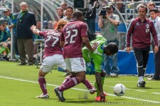 Eddie Johnson double-teamed by Kimura and Wynne
