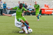 Steve Zakuani receiving a crunching tackle