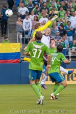 Sounders - Rapids: Bryan Meredith punches clear above Conor Casey