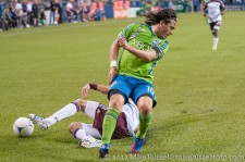 Sounders - Rapids: Drew Moor cleanly tackles the ball away from Mauro Rosales