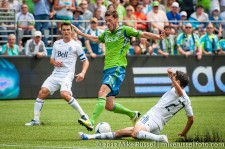 Sounders-Vancouver: Jun Davidson tackles the ball away from Brad Evans