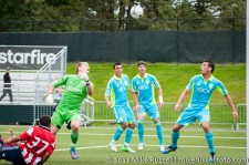 Sounders-Chivas Reserves: Mike Seamon waits for the ball to drop