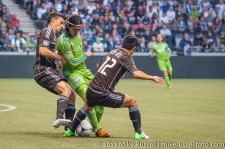 Sounders-Whitecaps: Alain Rochat, Fredy Montero, and Y.P. Lee