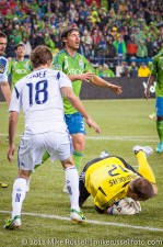 MLS Playoffs - Sounders v LA: Josh Saunders takes the ball from Jeff Parke's feet